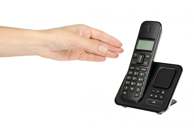 Modern landline cordless phone with hand, old technology concept.