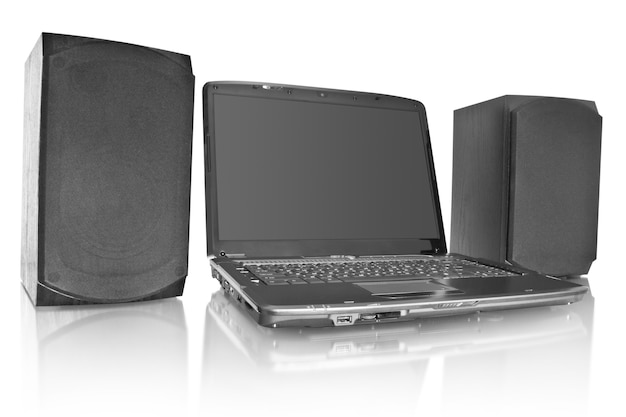 Modern laptop with computer speakers isolated on white