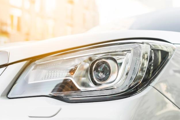 Modern led headlight of white automobile