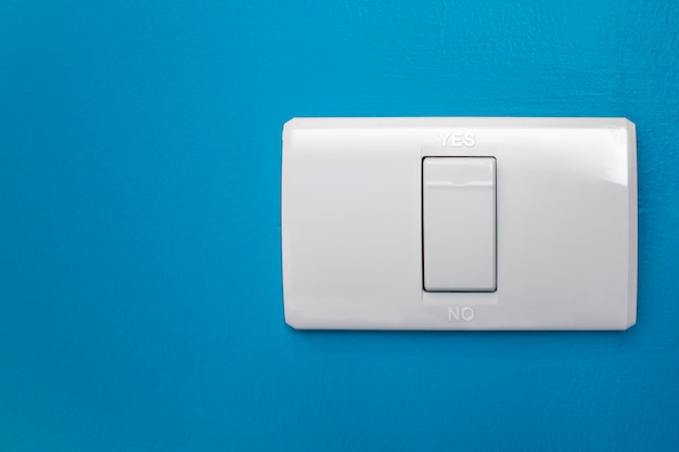 Modern light switch on a blue wall