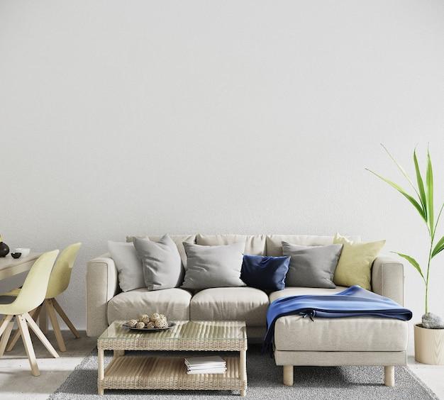 白い壁の前にソファと枕のあるモダンなリビングルームのインテリア
