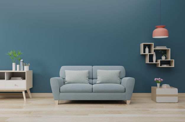 Modern living room interior with sofa and green plants, lamp, table on dark blue wall background