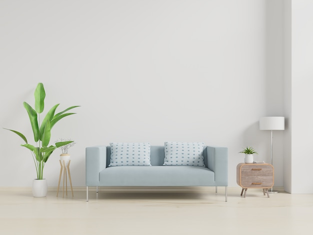 Modern living room interior with sofa and green plants, lamp, table on white wall.
