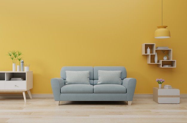 Modern living room interior with sofa and green plants, lamp, table on yellow wall.