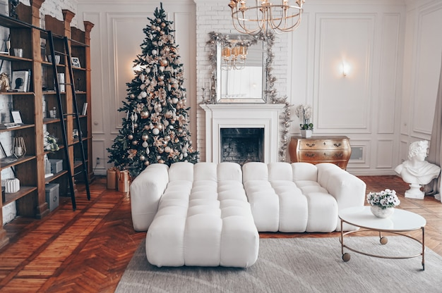 Modern living room white interior with classic elements and christmas decorated tree