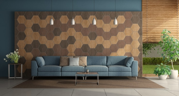 Modern living room with blue sofa in front of a wall with hexagonal wooden tiles - 3d rendering