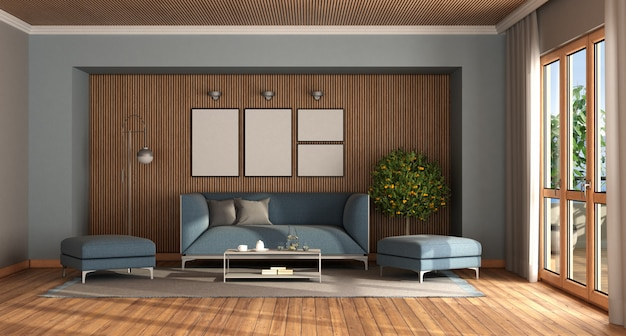 エレガントな青いソファーとフットスツール付きのモダンなリビングルーム