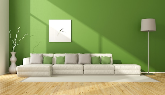 Modern living room with white sofa against green wall