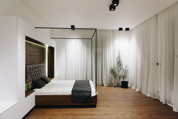 Modern luxury bedroom interior, beautiful minimalistic design king sized bed