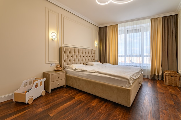 Modern luxury bedroom interior with double bed in beige and brown warm colors