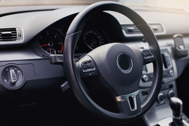 Modern luxury car interior  steering wheel shift lever and dashboard car interior luxury inside steering wheel dashboard speedometer display