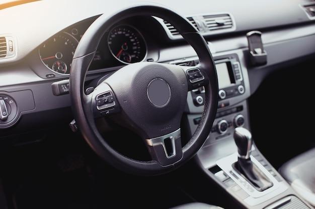 Modern luxury car interior  steering wheel shift lever and dashboard