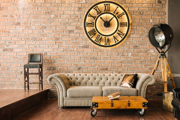 Modern luxury living room with stone wall, sofa with clock, interior