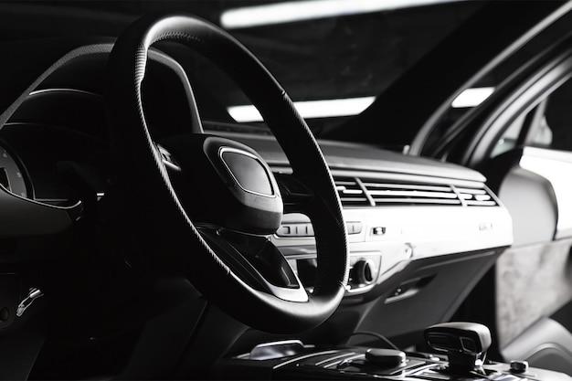 Modern luxury prestige car interior dashboard steering wheel black leather interior