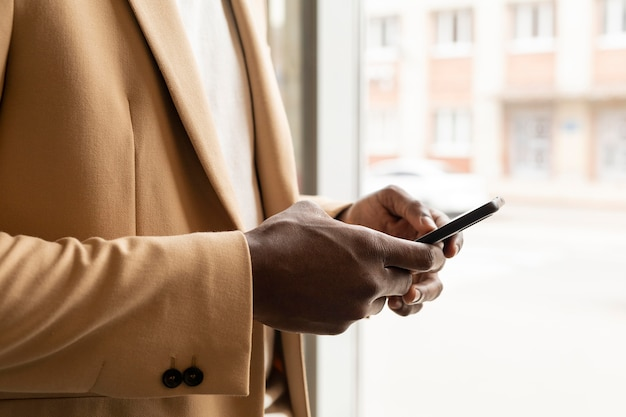 Modern man in beige suit