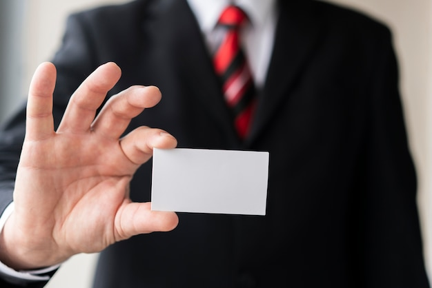 Modern man holding blank business card