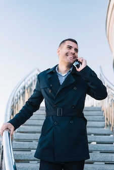 Modern man making phone call