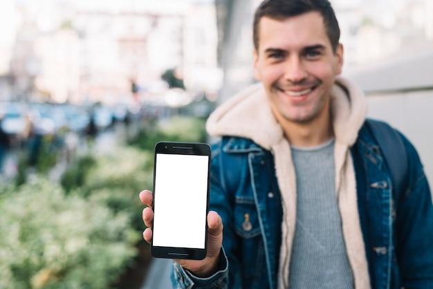 Modern man presenting smartphone template