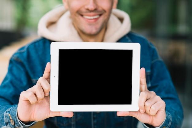 Modern man showing tablet mockup
