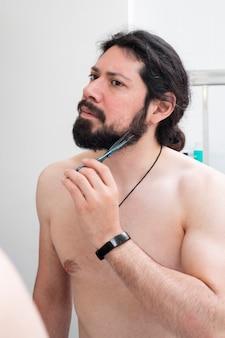 Modern man taking care of his beard