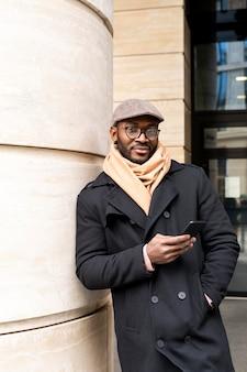 Modern man using his phone outdoors