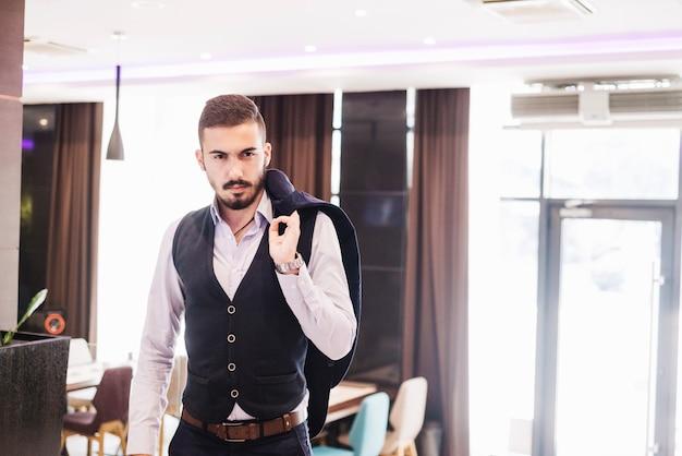 Modern man wearing vest