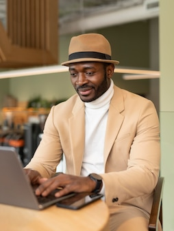 Modern man working in a caffe