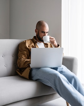 Modern man working on laptop