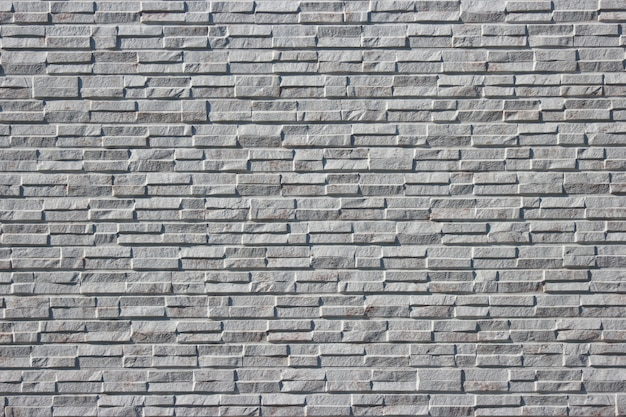 Modern masonry gray brick tile surface texture design wall background.