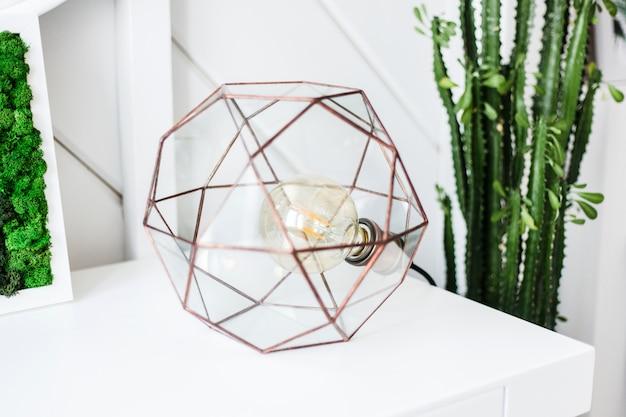 Modern metal lamp in light interior, housing and design