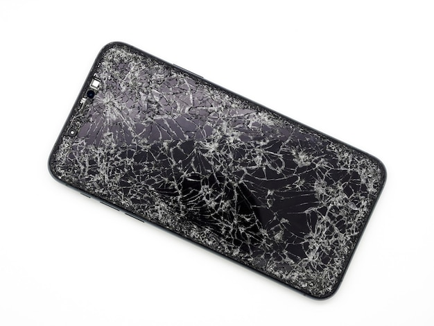 Modern midnight green smartphone with a broken glass display and damaged curved body close-up isolated on white background