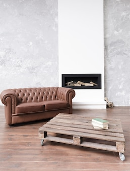 Modern minimalist living room with leather sofa and fireplace