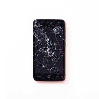 Modern mobile smartphone with a broken screen isolated. view from above