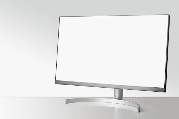 Modern monitor on white table and light