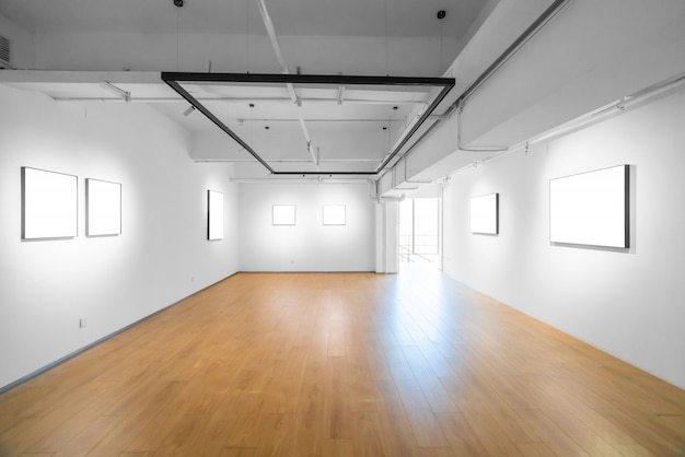 Modern museum art, empty gallery interior space, white walls and wood floors