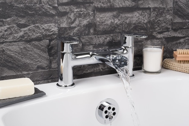 Modern and new steel faucet with the ceramic bathtub  in the bathroom