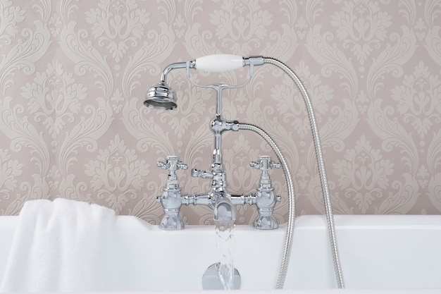 Modern and new steel faucets with the ceramic bathtub in the bathroom
