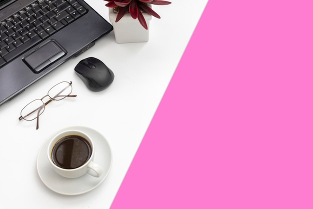 Modern office accessories on white seperated with pink paper