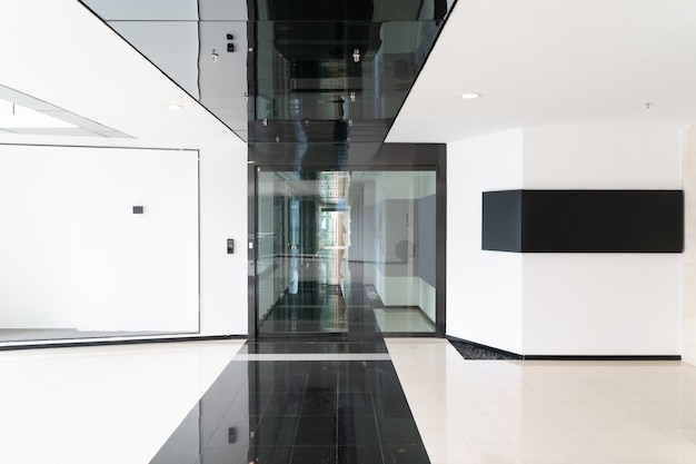 A modern office building with glass doors and windows