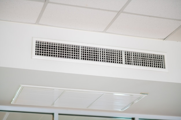 Modern office interior with air conditioner on the wall