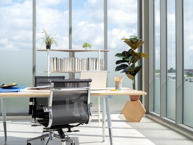 Modern office interior with huge windows with blue sky view.