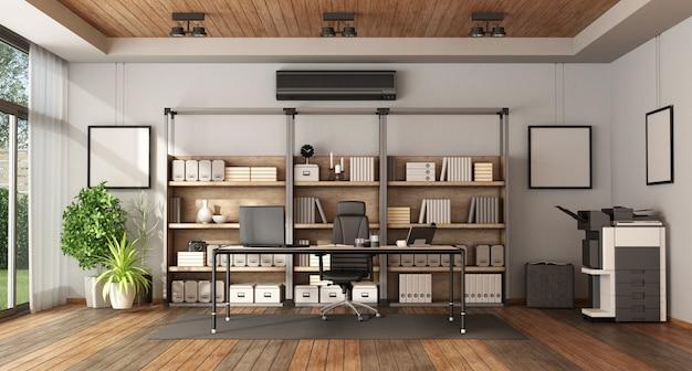 本棚とデスクのある近代的なオフィス