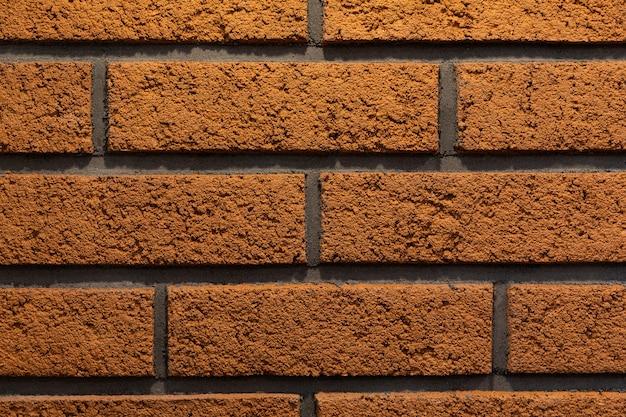 モダンなオレンジ色のレンガの壁のクローズアップ