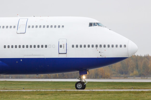 Modern passenger double-decker airplane is taxiing to take off. wide-body aircraft on runway