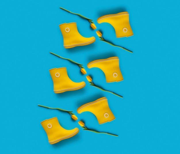 Современный узор из желтых резиновых сапог и тюльпанов на синем фоне