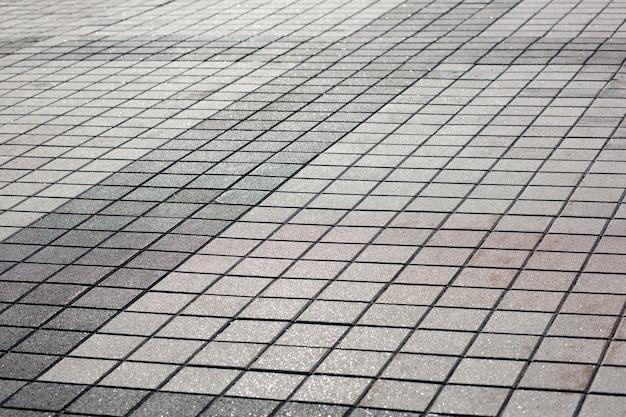 Современная пешеходная дорога, вымощенная бетонным камнем. снимок крупным планом