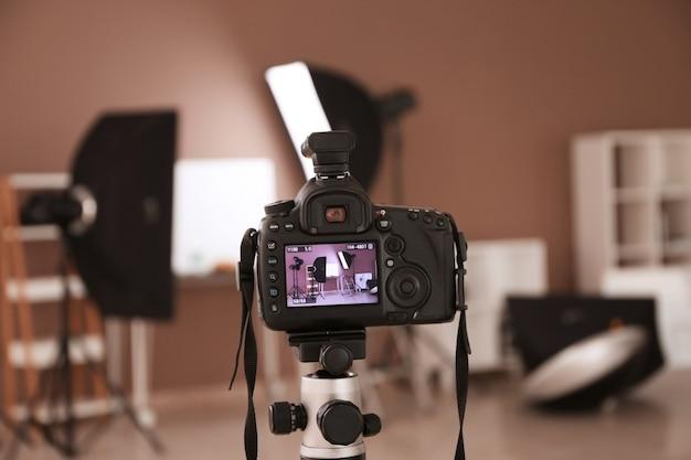 Modern photo studio on screen of professional camera