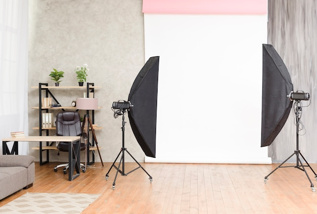 Modern photography studio with lights and background