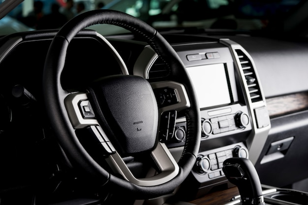Modern pickup truck interior, touch screen panel, leather seats and automatic transmission lever - dark light