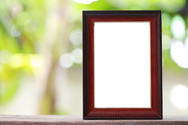 Modern picture frame placed on a wooden floor.